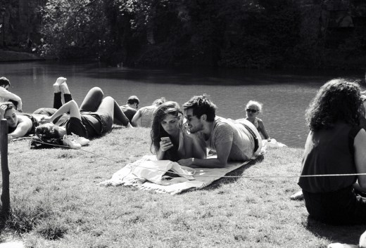 people laying in the grass, Parc des Buttes Chaumont, Paris