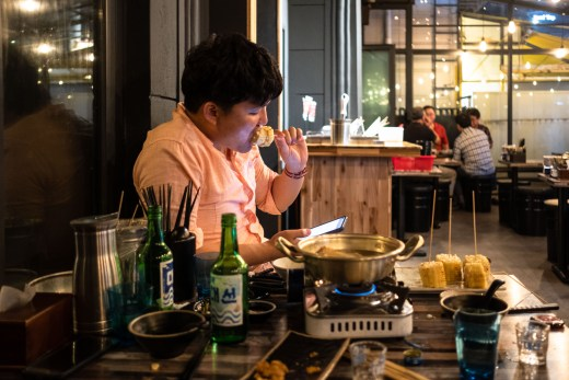 a lonely man eating in a korean restaurant