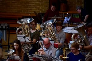 tenor horns and tubas playing in the first rehearsal