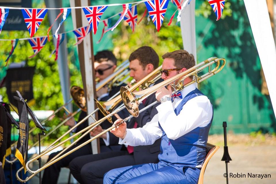 Trombones playing on Twickenham Riverside. Image credit: Robin Narayan