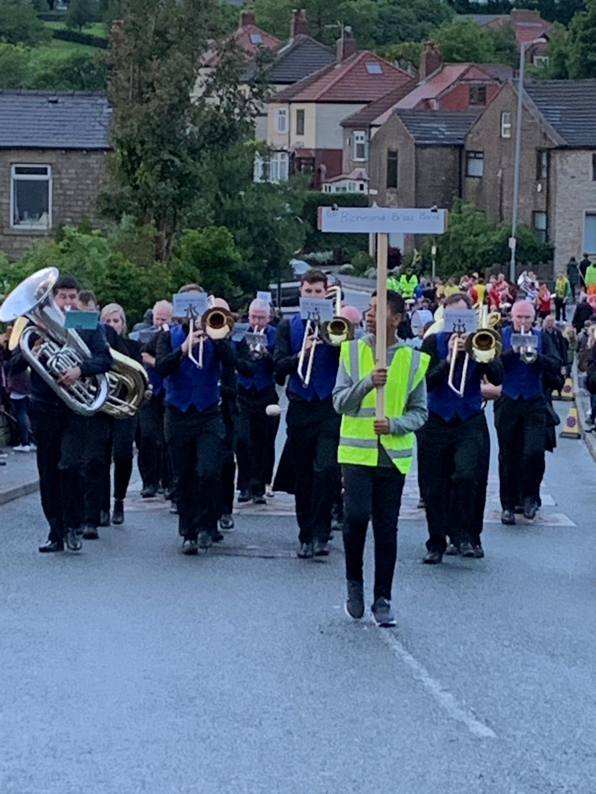 Richmond Brass Band marching up the hill at Lydgate