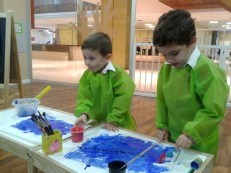 boys painting blue