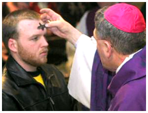 priest putting ashes on forehead