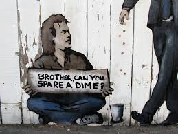 "guy sitting on the street holding a sign that says ""brother, can u spare a dime"""