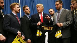 trump with iowa hawkeye football players