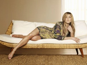 jennifer aniston reclines on a divan