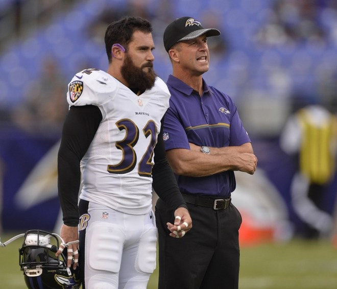 ravens head coach john harbaugh and eric weddle
