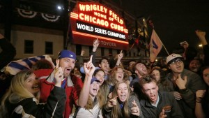 cubs fans celebrate outside of historic wrigley field in chicago
