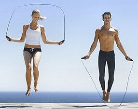 a woman and a man jumping rope