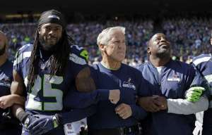 richard sherman and pete carroll arm in arm