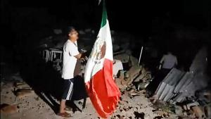 angel sanchez pulled the mexican flag out of the rubble