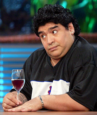 maradona enjoying a glass of wine