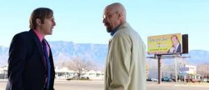 saul goodman and walter white in front of a billboard of saul goodman