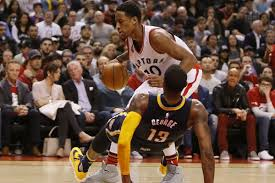 paul george taking a charge from demar derozan when george played for the pacers and derozan played for the raptors