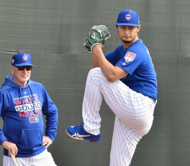 cubs manager joe maddon watches yu darvish pitch