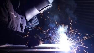 a welder making sparks