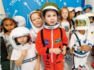 kids make believing they are astronauts