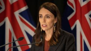 new-zealand-prime-minister-jacinda-adern-in-front-of-new-zealand-flag