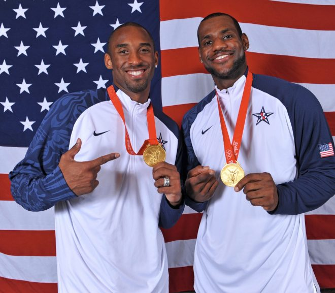 kobe-and-lebron-wearing-gold-medals-in-front-ol-the-american-flag