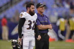 ravens head coach john harbaugh and eric weddle