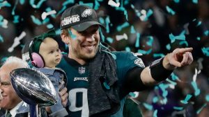 nick roles celebrates winning super bowl lii with his daughter
