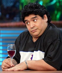 maradona enjoying a glass of wine