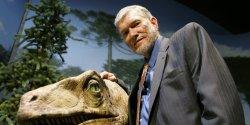 Ken Ham posing next to a dinosaur exhibit