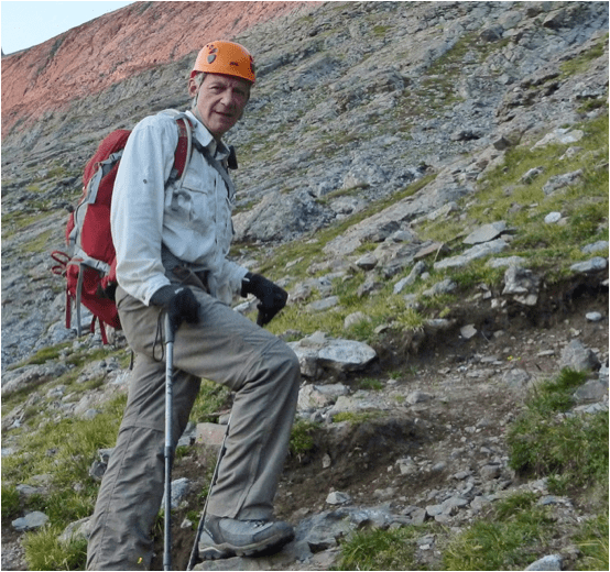 Rick Crandall ascending a trail using the cross-over step