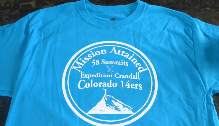 "A tshirt that says ""Mission Attained: 58 Summits. Expedition Crandall Colorado 14ers"""