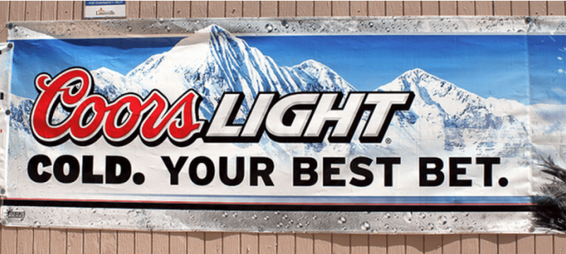 """Picture of a Coors Light banner with Rocky Mountains in the background. The banner reads """"Coors Light. Cold. Your best bet."""""""