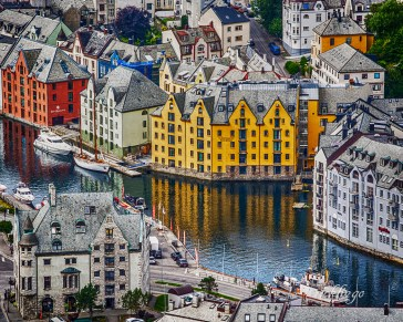 """Norway. """"Certificate of Award"""" in the area of City / Urbanscape Photography for July, 2018, at the Universe of Color Photography and placement in its online magazine. 5th place award in City, Streets and Park at international website Pixoto. Named """"Superb Composition"""" Peer Award on international website ViewBug."""
