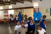 Floyd with Children in Children's Center