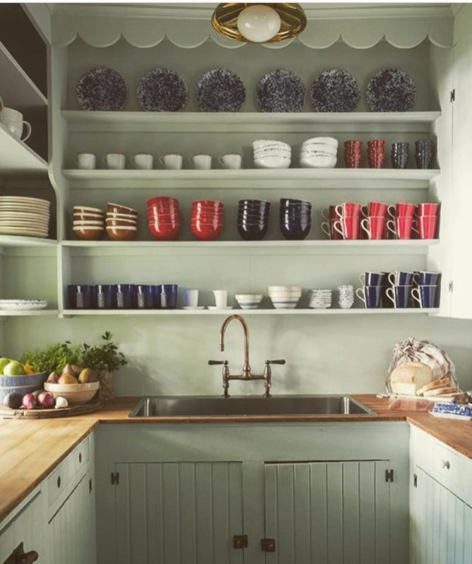 kitchen pantry with microwave shelf