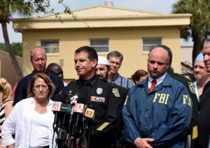 Orlando police chief John Mina and FBI agent Ron Hopper_ Photo: Kevin Kolczynski_Reuters