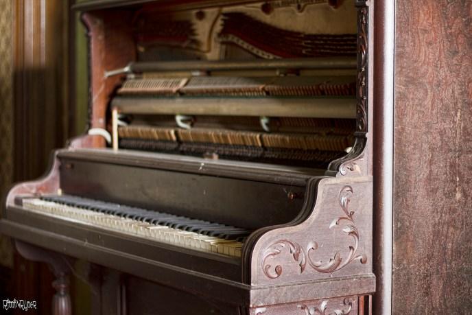 abandoned stone house piano
