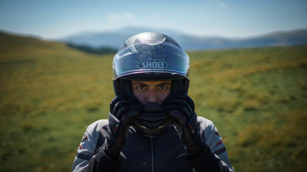 Who is under the helmet