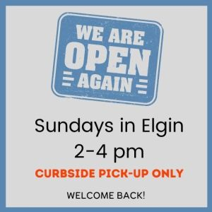 Opening sign announcing Sunday hours are back at the Elgin Branch 2 to 4 pm