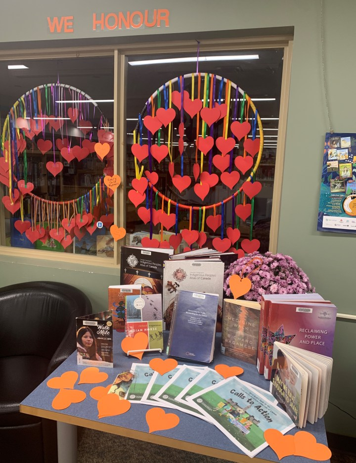 Display to honour the National Day for Truth and Reconciliation with a hoop of hearts and library resources