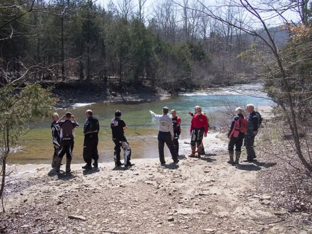 Our Friday ride group contemplating a wide river crossing.