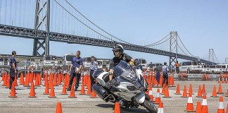 Quinn Redeker competing at the Third Annual International Police Motorcycle Skills Competition, held in San Francisco, California, on August 1, 2015. Negotiating tight cone patterns with speed and precision requires remarkable clutch and throttle control, excellent balance and laser-like focus. (Photography by the author)