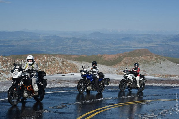 Three riders pause on the way up Pikes' Peak. The ladies were initially held up at the base of the mountain, with the road closed due to snow. They were eventually allowed up, but slush and snow remaining at the top made the pavement slippery. Imagine how much more difficult it must've been for the Van Buren sisters, on unpaved roads in 1916. (Photo: Christina Shook)