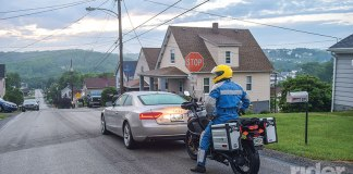 This rider has left no room for escape, is in physical and mental neutral and is highly vulnerable to that distracted driver approaching from behind.