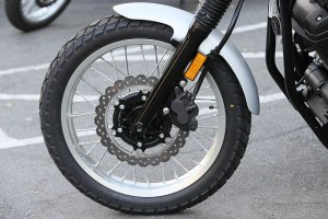 Spoked aluminum rims (19-inch front, 17-inch rear) are shod with Bridgestone Battle Wing tires with a special block tread pattern, and they carry tubes.