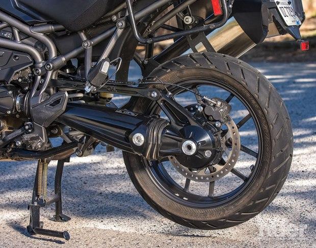 Like the Honda, the drive shaft is inside an aluminum single-sided swingarm.