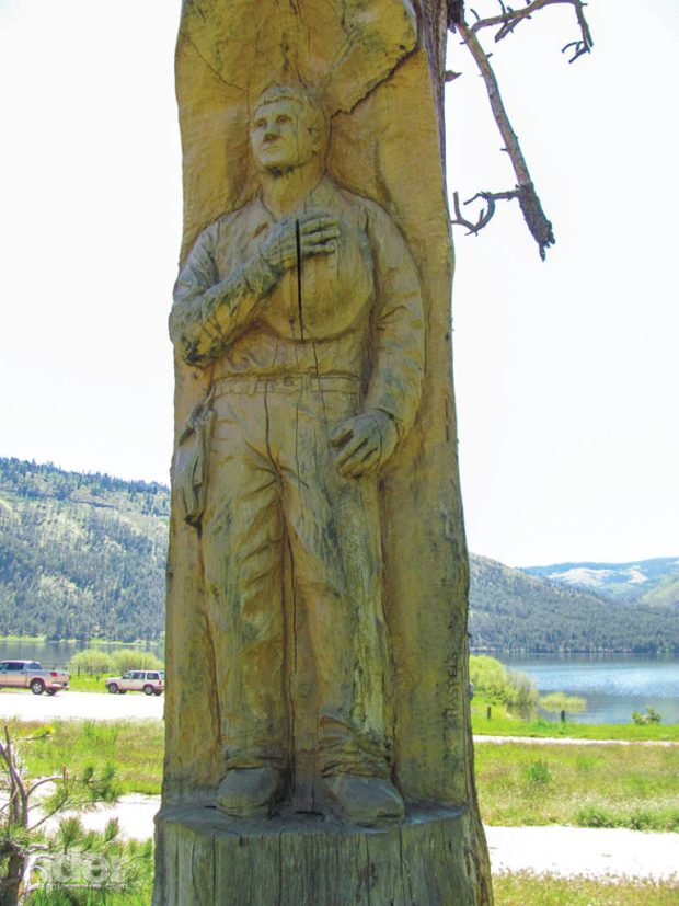 A carving in a burnt-out tree next to the Vallecito Lake Community Center memorializes a contract sawyer killed by a falling tree during the Missionary Ridge fire.