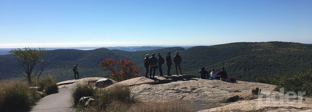 Part of the group pauses to enjoy the view from the base of the Perkins Memorial Observatory. If you look very closely, you can see the New York City skyline in the distance. (Photo: the author)