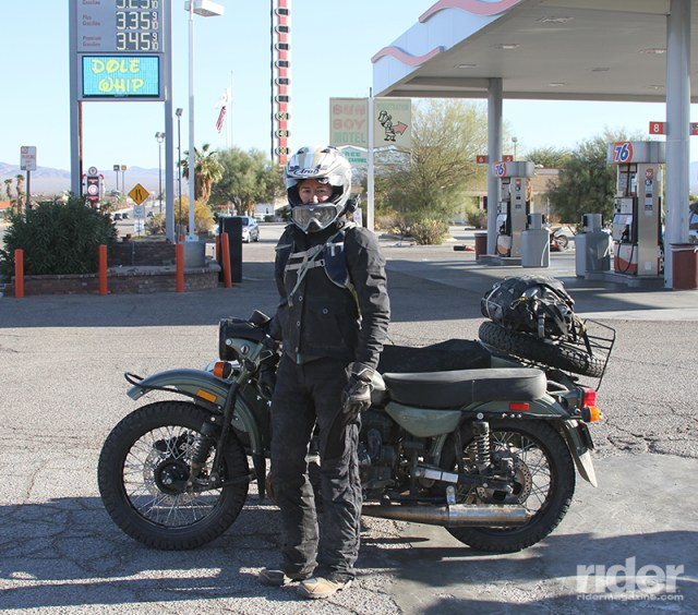 The Ural & I: The author poses with her 2016 Ural Gear-Up in Baker, California, where the World's Tallest Thermometer (seen in the background) indicated 50 degrees. (Photos by Kurt Yaeger)