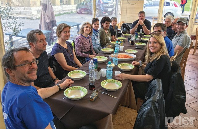 Our group waits patiently for me to take a photo before tucking into a delicious lunch of homemade pasta in Ficuzza.