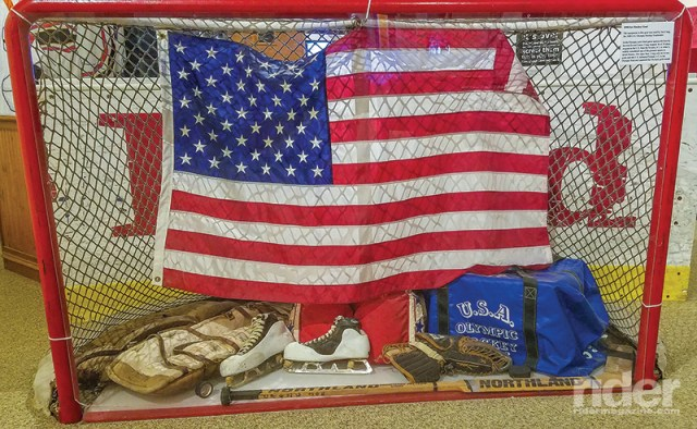 Hockey goal, goalie equipment and Old Glory from the 1980 Olympics in Lake Placid