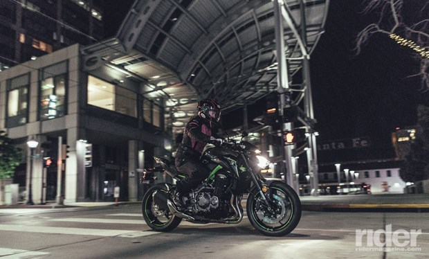 The crouched posture of the Z900, along with its sinister black and gray paint, and green frame and accents, looks right at home on darkened city streets.